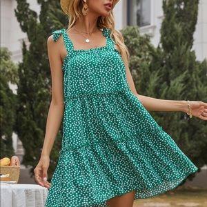 Dots tie shoulder ruffle hem mini dress